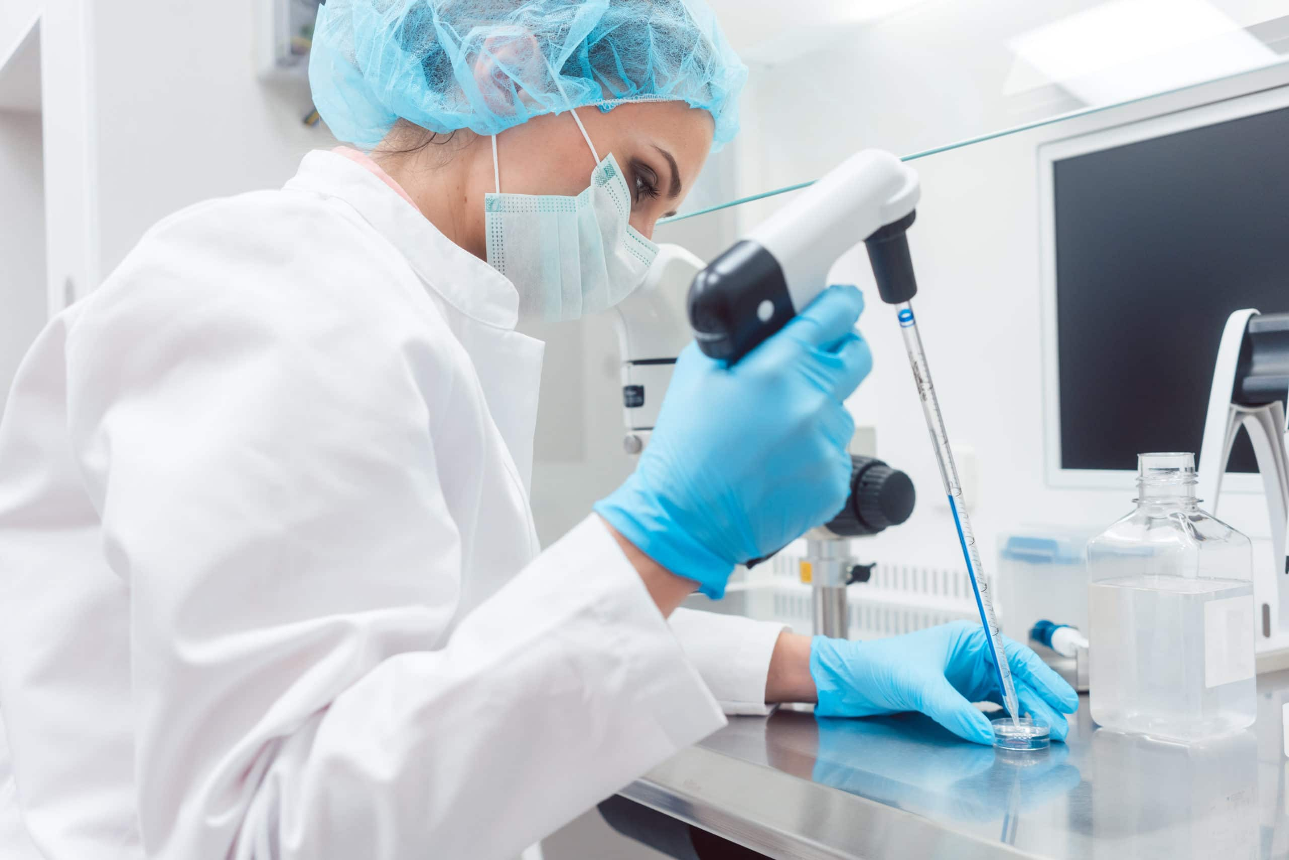 Scientist in lab conducting biotechnological experiment using pi